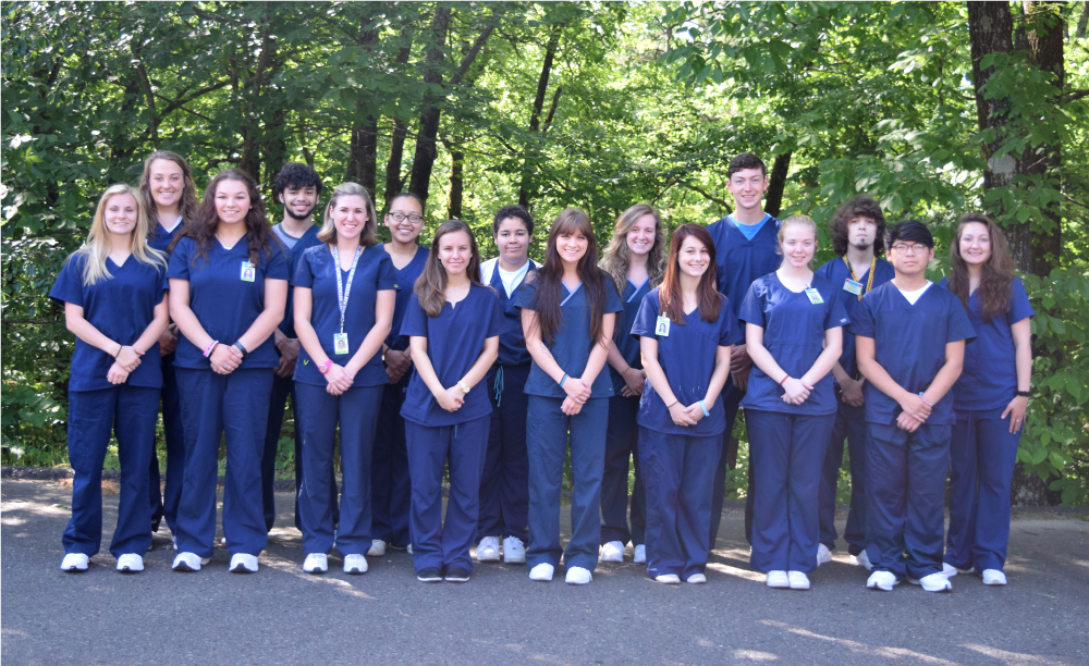 NPTC Medical Students, dressed in scrubs, standing for a group photo.
