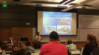 Solar expert, Bob Nagy, lecturing with a student body on the how the world is moving forward with solar energy.
