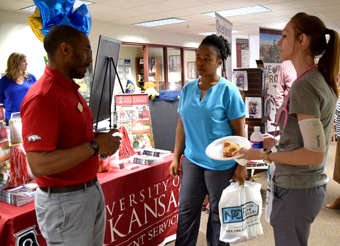 University of Arkansas representative speaking to two student at the NPU transfer center.